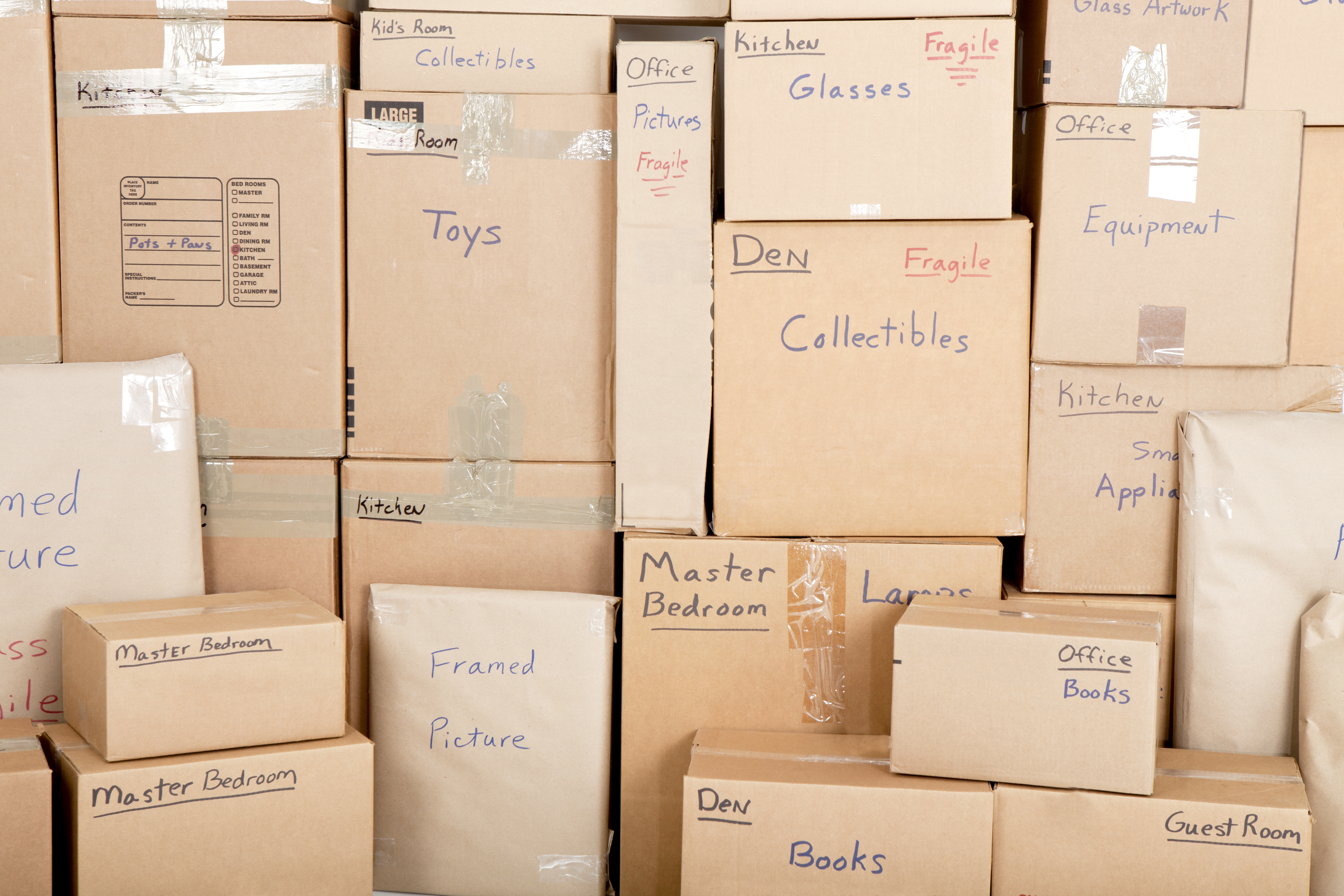 blog image of moving boxes; blog title: Avoid the Stress of Moving With These 5 Tips