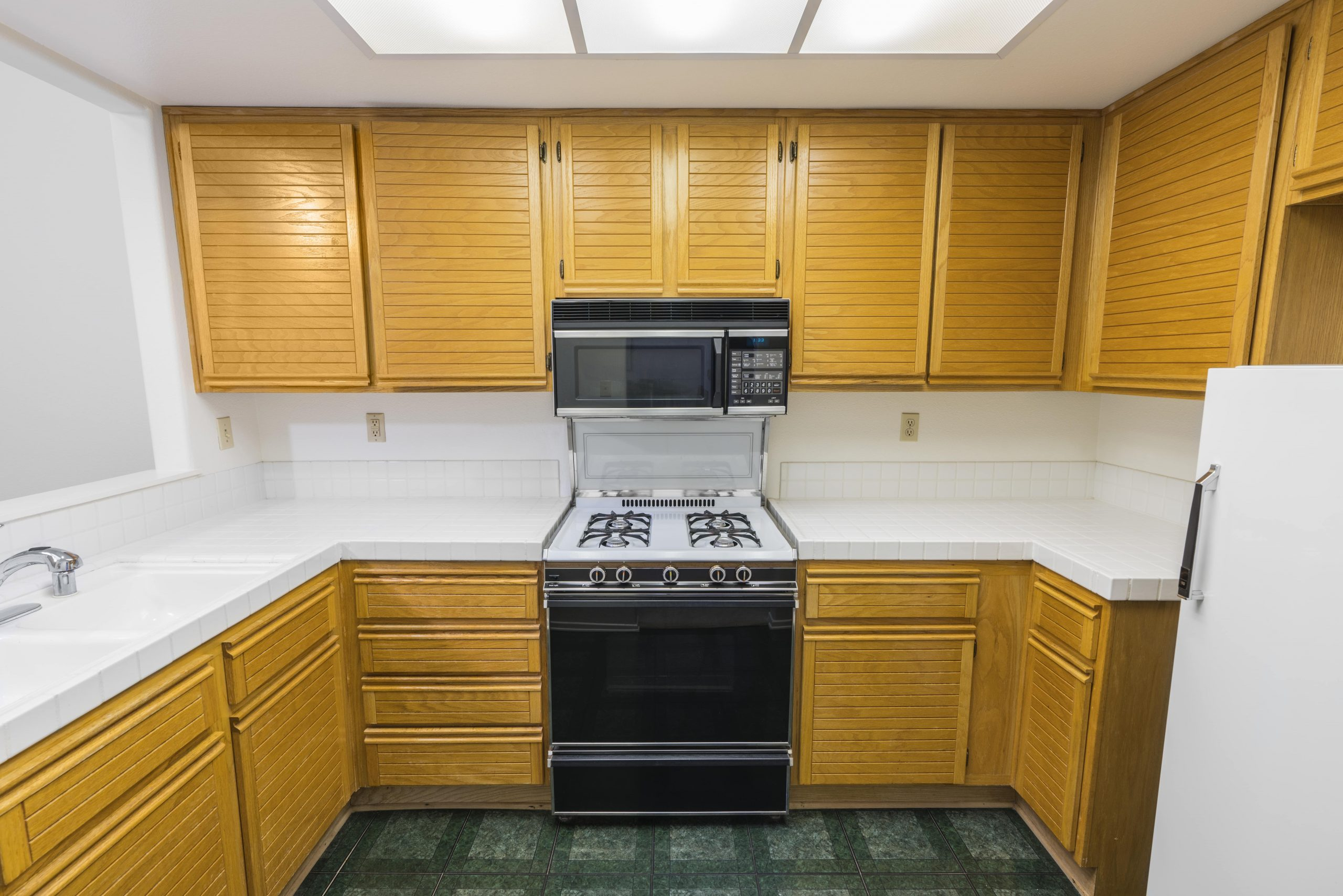 blog image of an old, outdated apartment kitchen