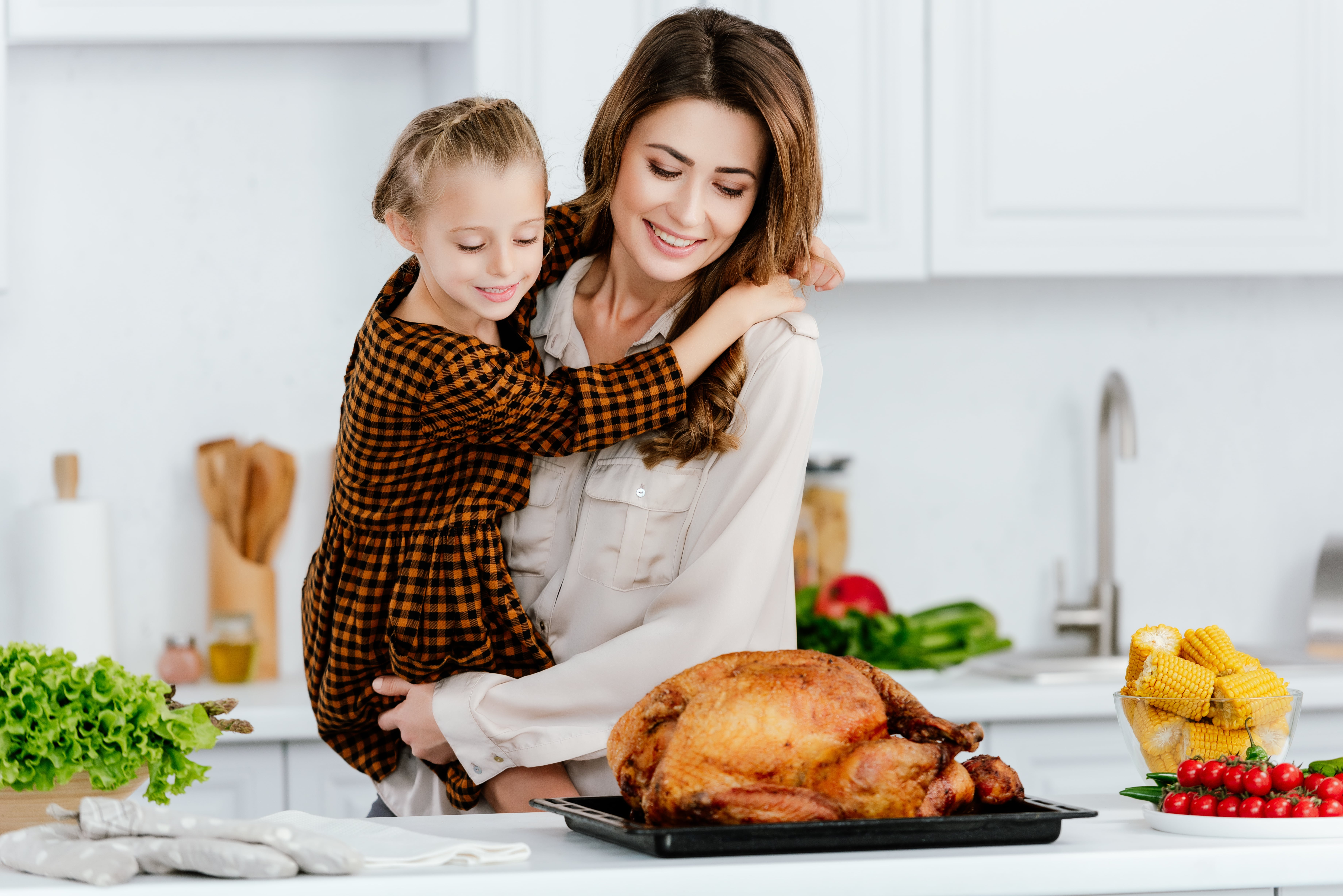 blog image of mom and daughter making turkey; blog title: thanksgiving safety tips