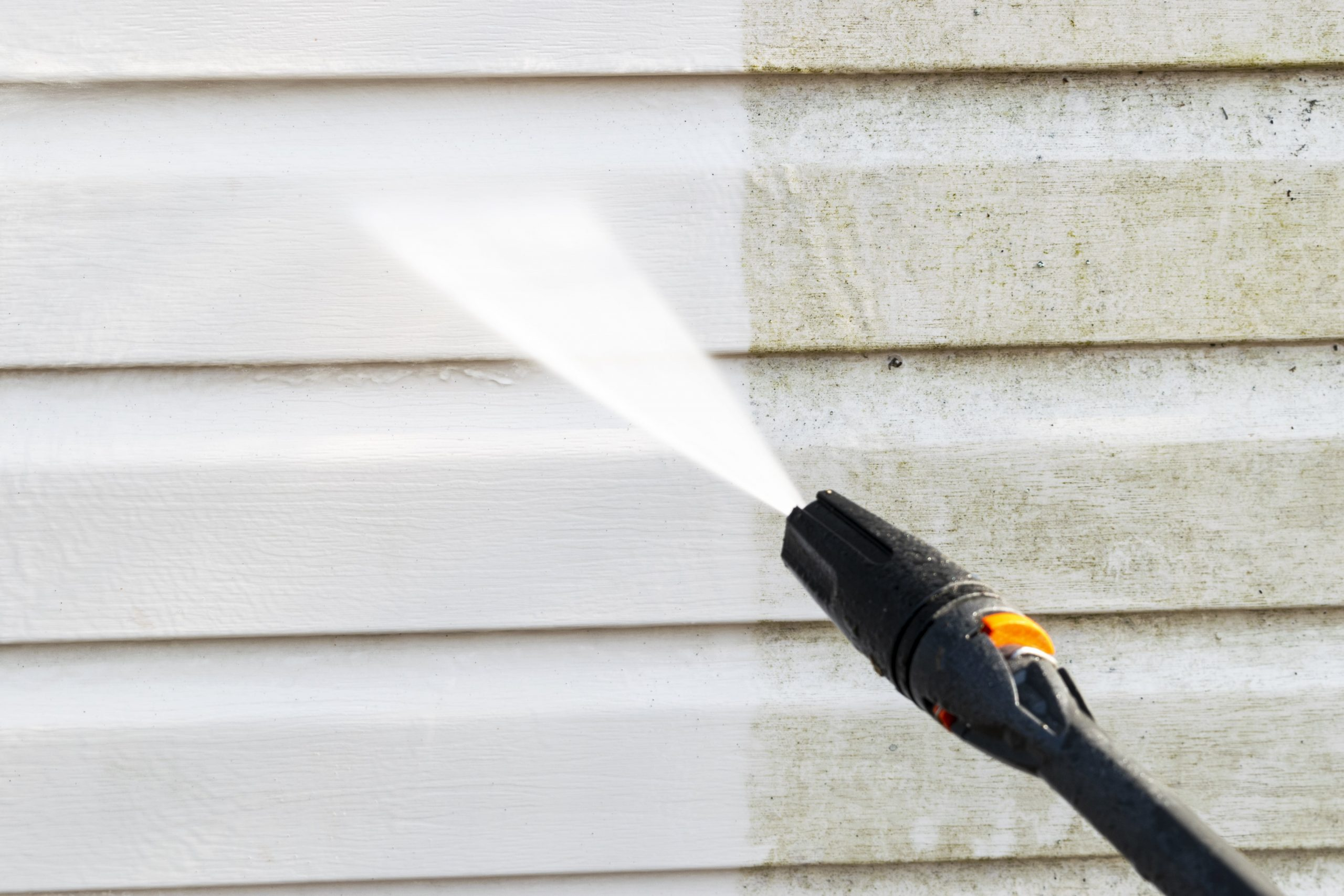 image of power washed building siding clean vs dirty side