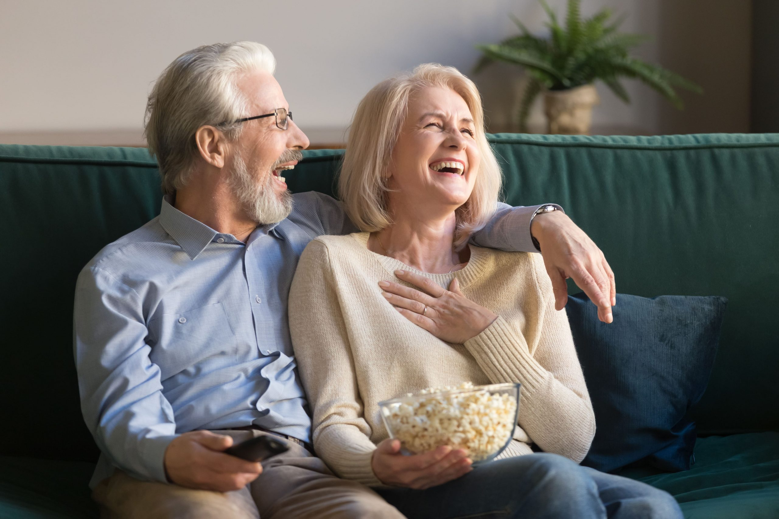 blog image of a middle aged baby boomer couple empty nesters living in their rental luxury apartment